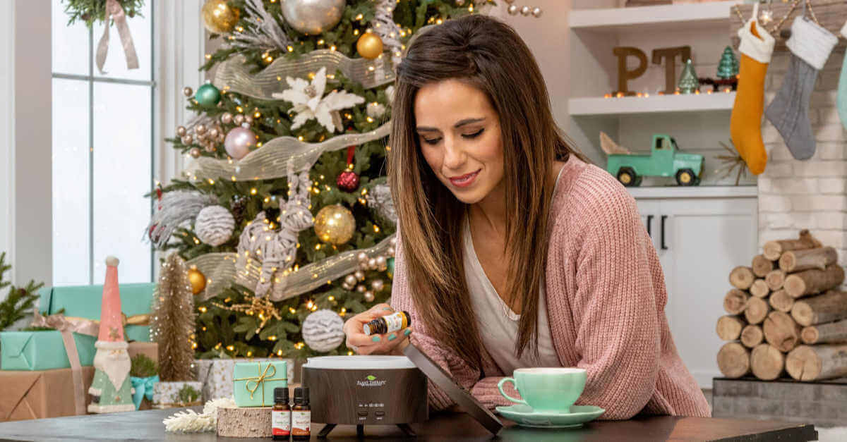 diffusing for the holidays woman using a Plant Therapy diffuser