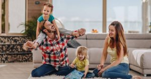 Happy family playing at home together