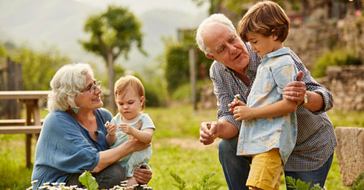 Grandparents caring for grandchildren outdoors