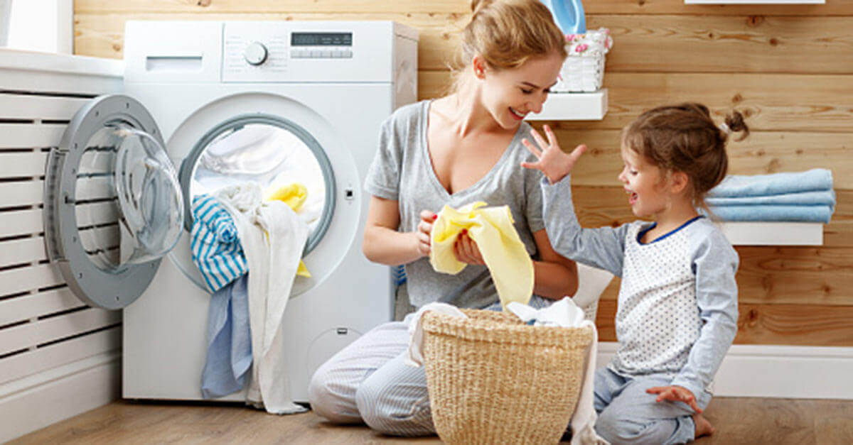 Mom and daughter doing laundry together
