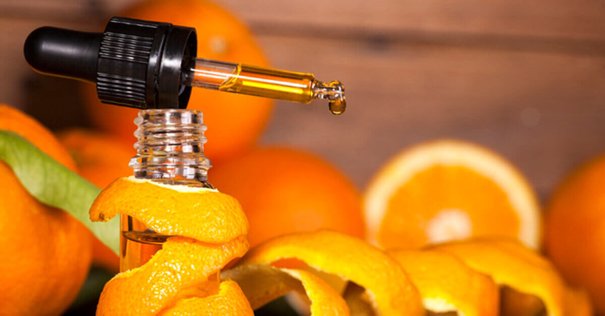 A drop of essential oil surrounded by orange peels