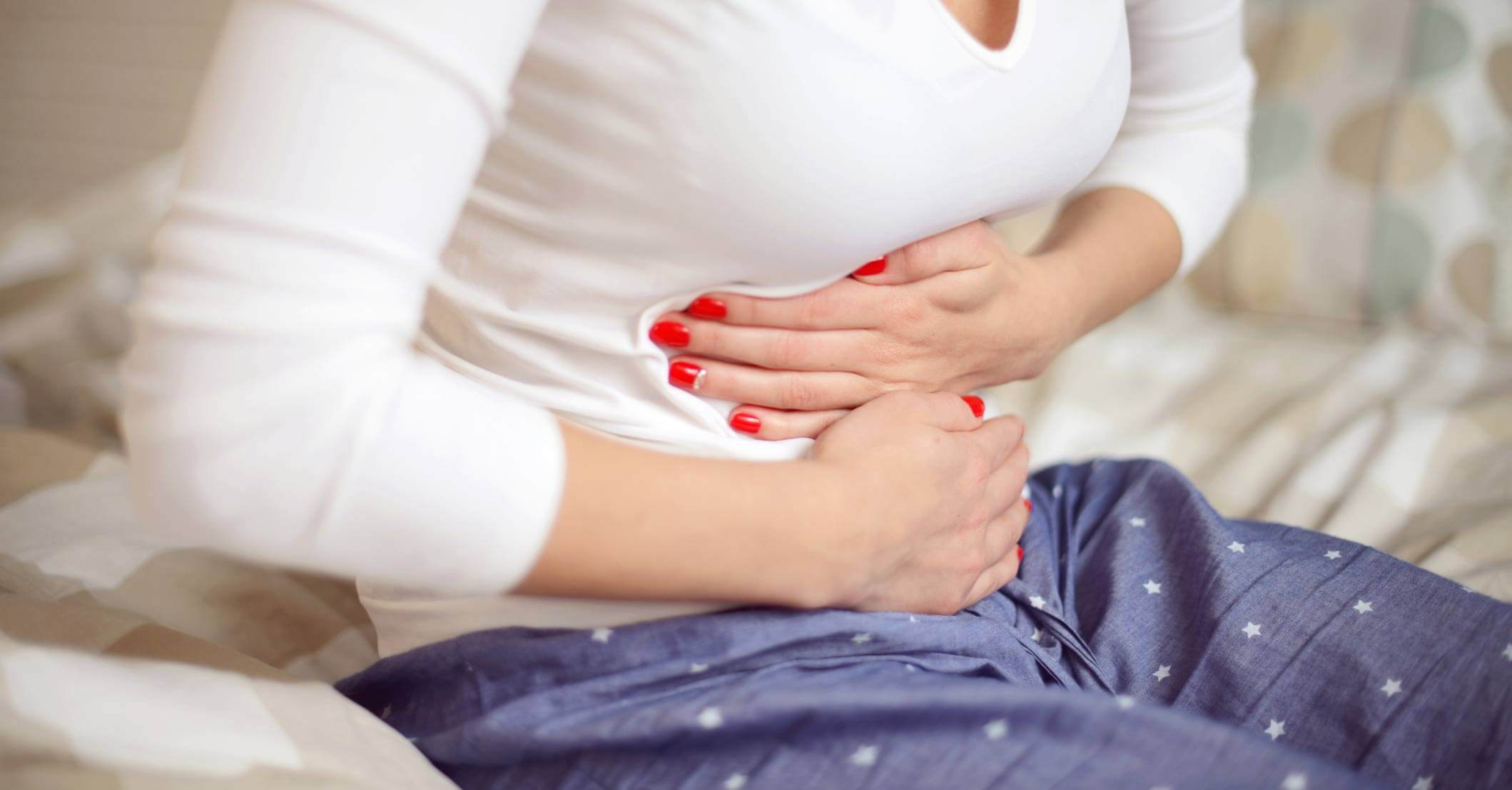 woman holding her stomach in discomfort passive diffusion