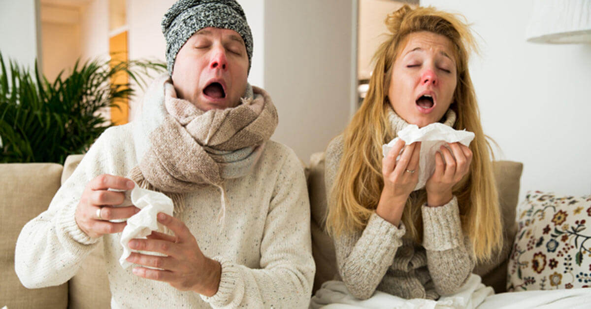 couple suffering through a cold