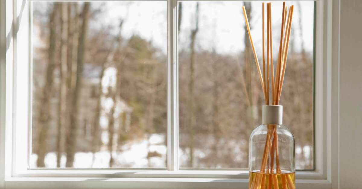 Reed diffuser next to a window