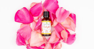 Delight Essential Oil blend surrounded by rose petals