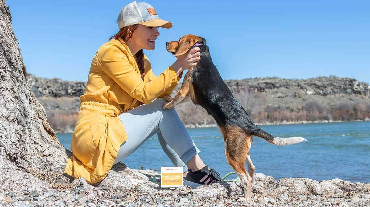 Woman and her dog with Pup & Pony essential oils