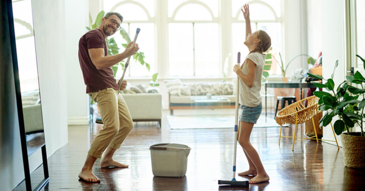 father and daughter cleaning the floor