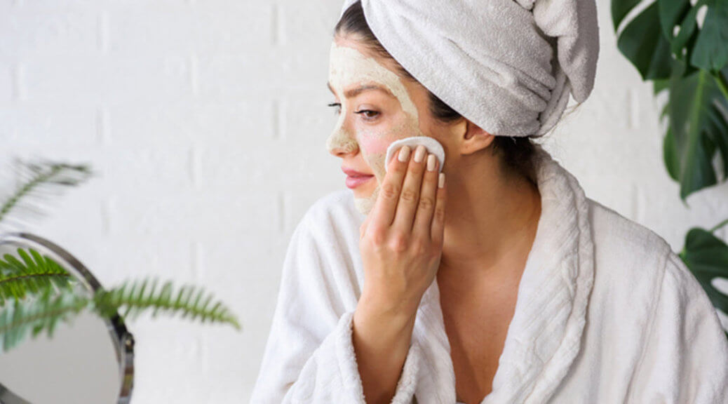 Woman wiping off a face mask