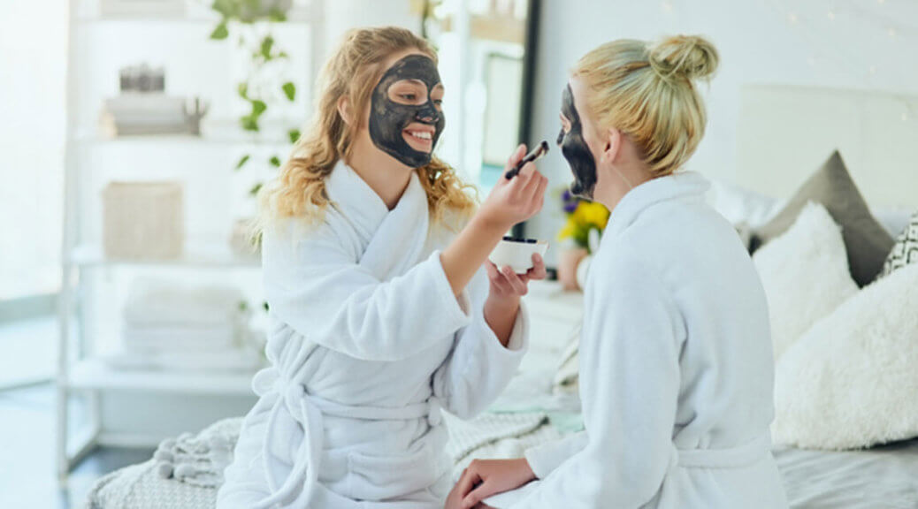 Friends applying a face clay mask