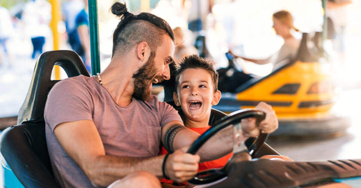 father and son in a bumper car