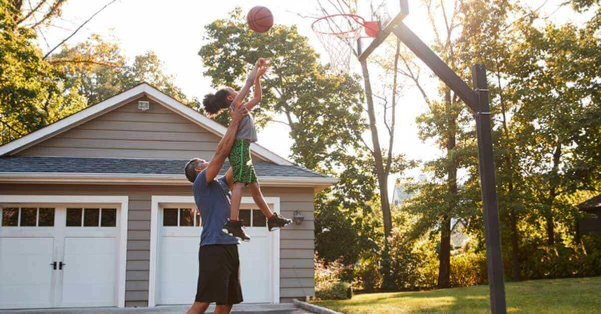Father playing basketball with his daughter