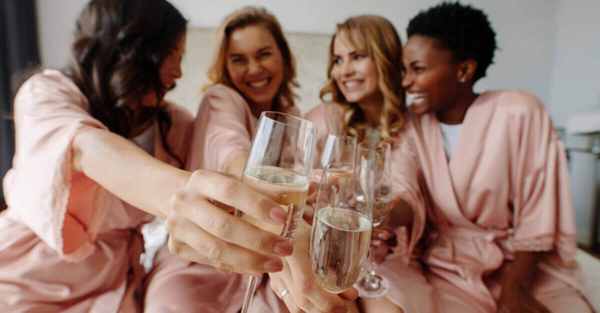 bridal party toasting before the wedding