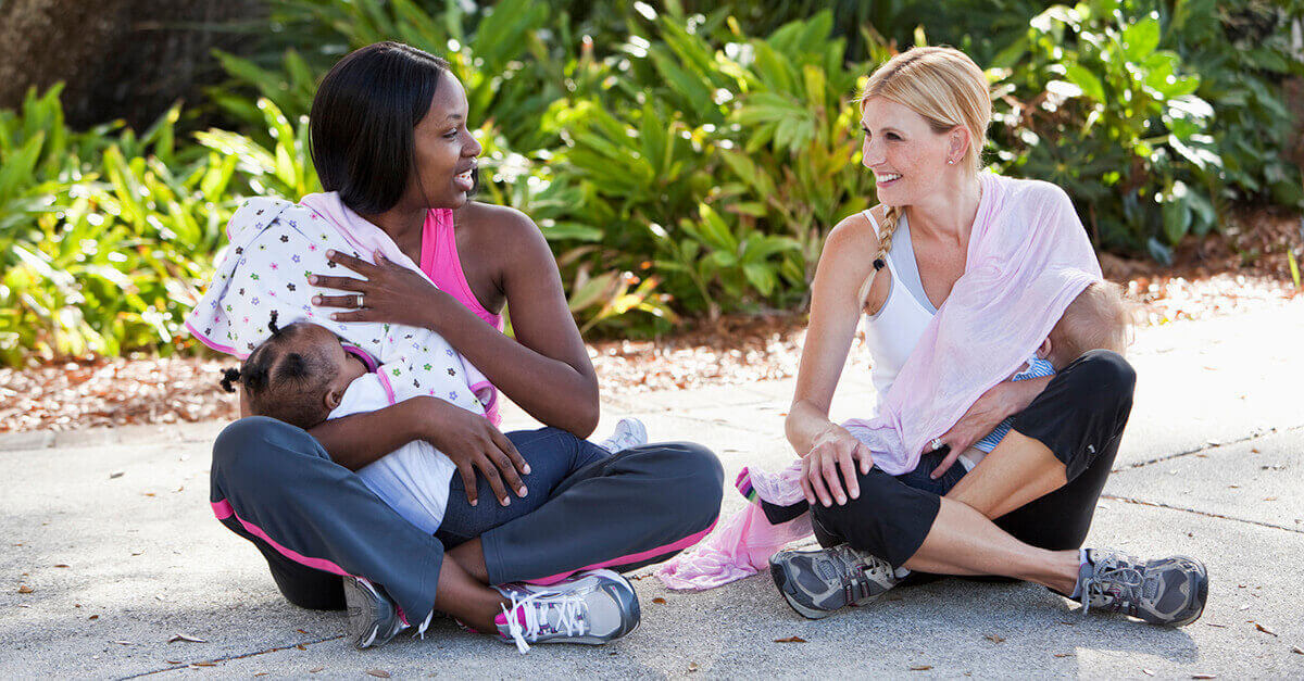 Two woman breastfeeding while out exercising