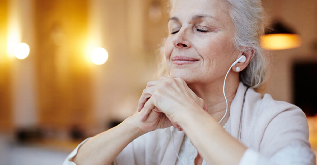 woman meditating with headphones