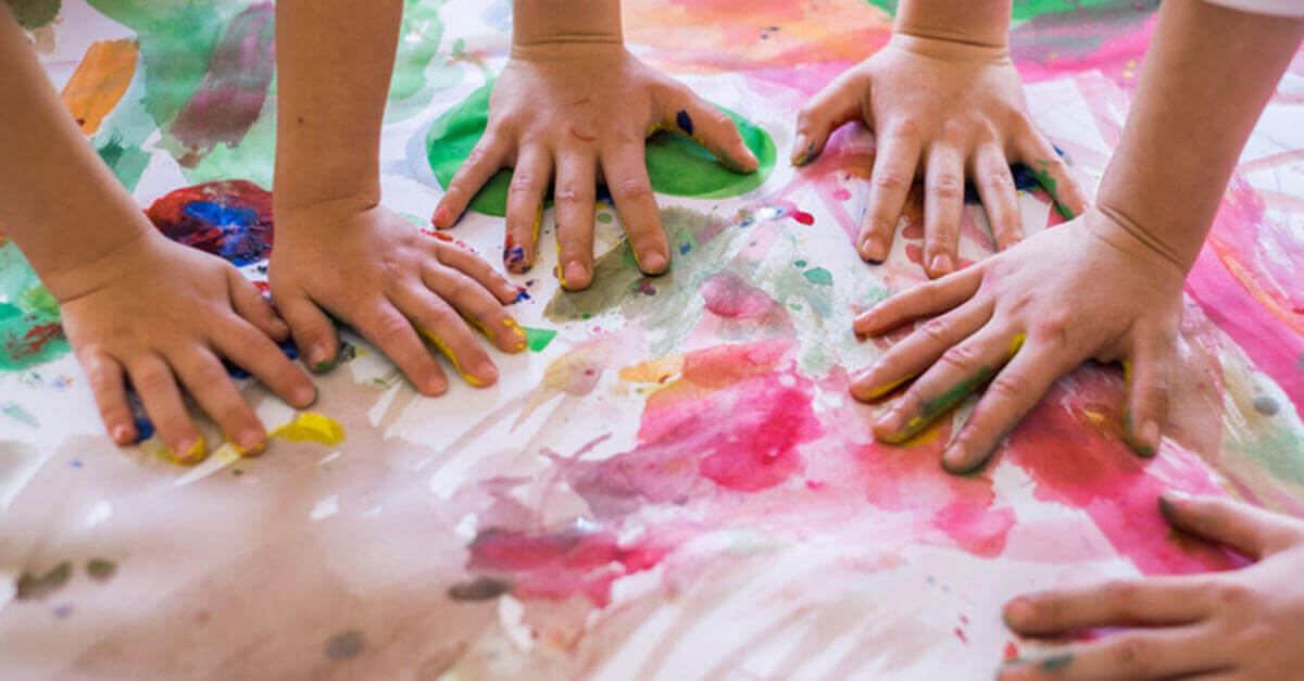 children doing finger painting