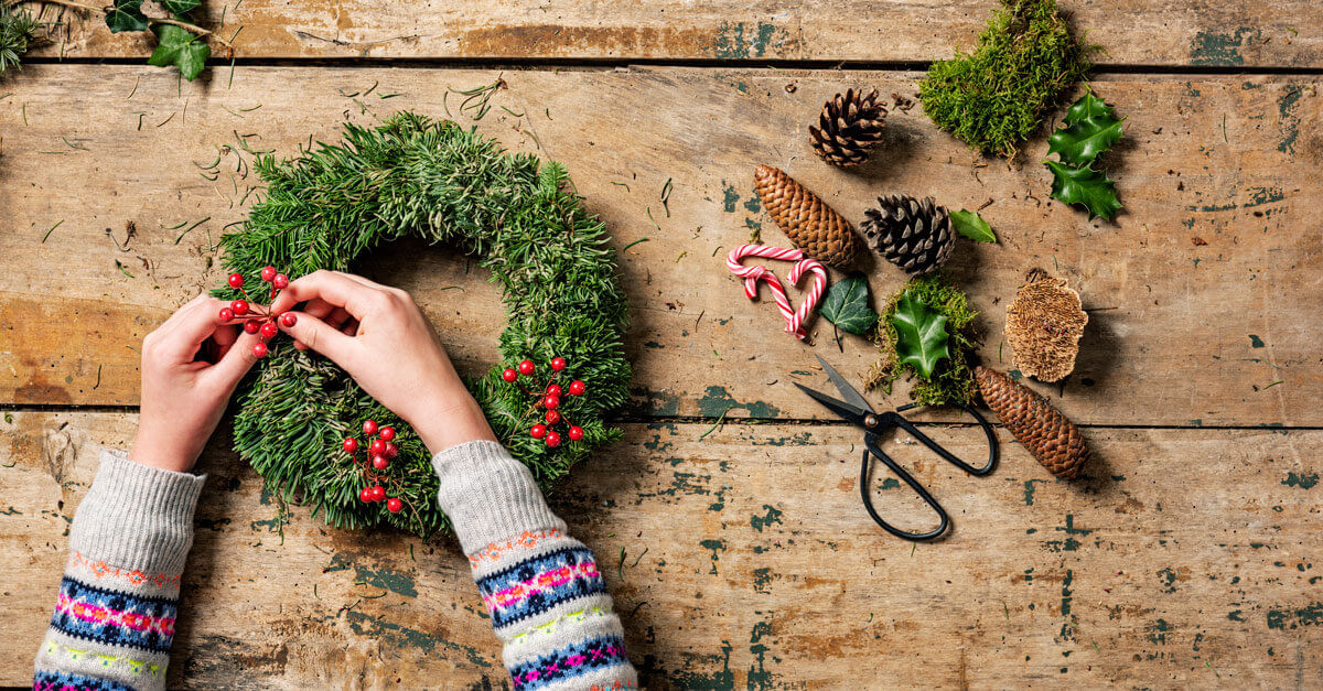 Woman making a Christmas wreath by hand