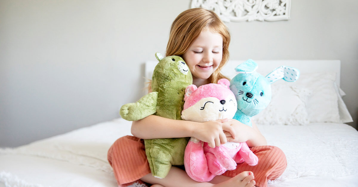 Young girl with Aroma Plush Pals