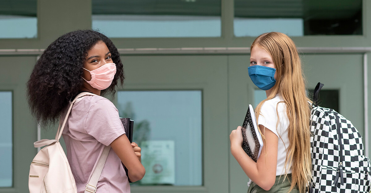 Young girls wearing face masks to school - dealing with maskne