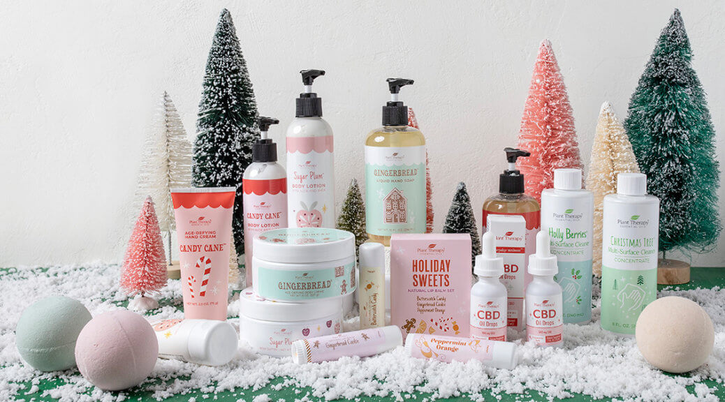 All the Holiday Seasonal Products on a table with snow and fake trees