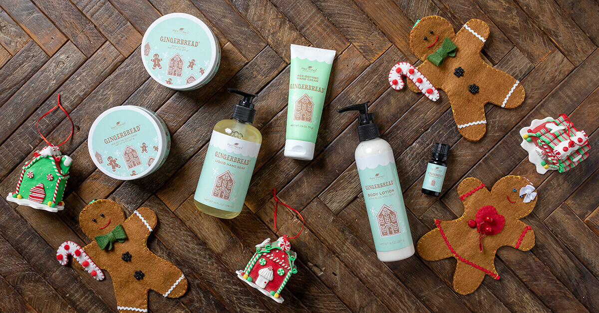 Gingerbread scented holiday products laying on a table