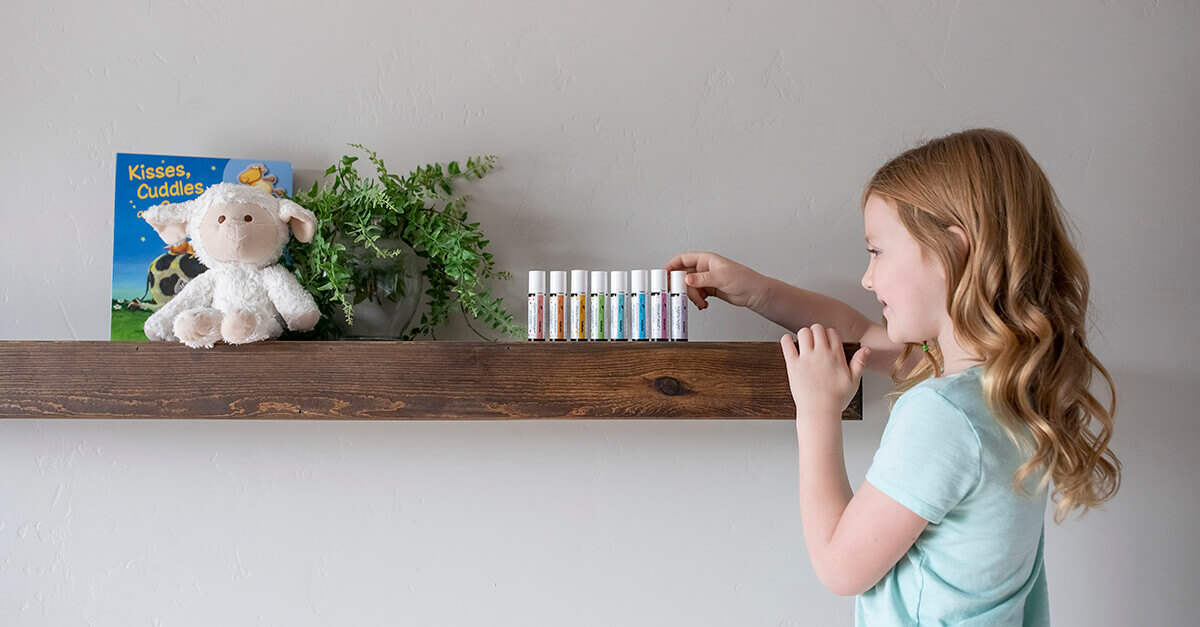 Child selecting Plant Therapy's KidSafe Essential Oils