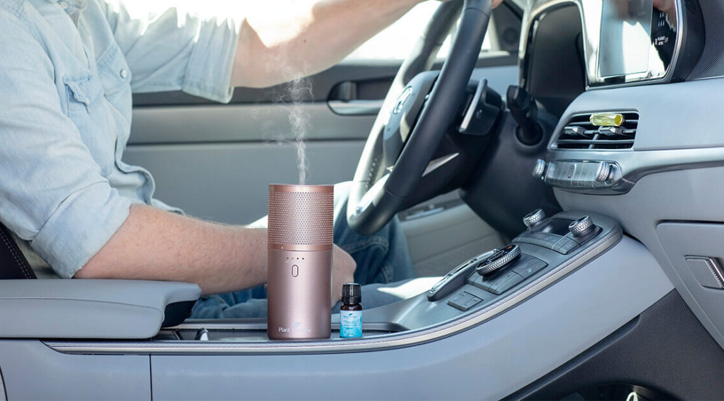 Man driving in car with Portable diffuser