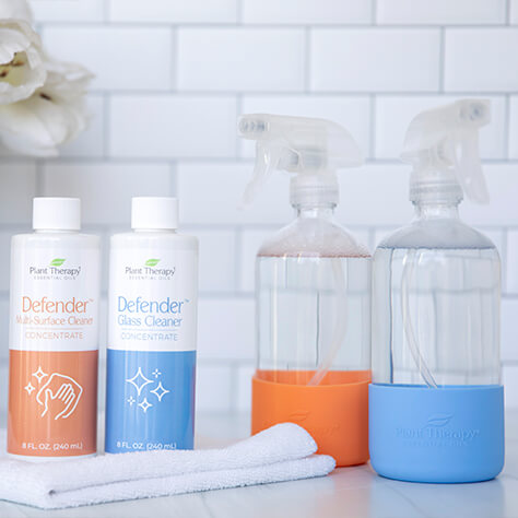 Defender Household cleaning concentrates and glass bottles