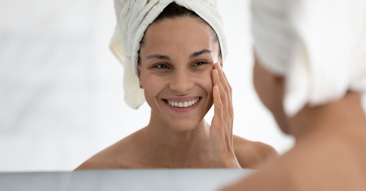 woman applying skin care product to skin